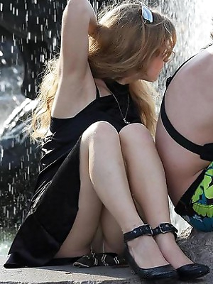 Upskirt in the streets. Shaved up skirt pussy pics.