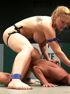 2 big titted blonds battle in non-scripted wrestling. Submission holds, face sitting, finger fucking