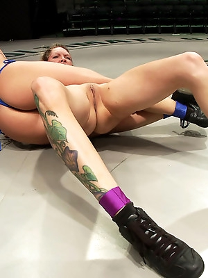 Ariel makes Rain cum on the mat, goes on to brutal victory<br>Nasty submission holds, Rain destroyed